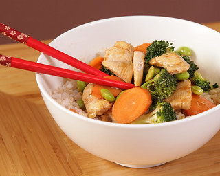 Picture of stirfry in a bowl with chopsticks.