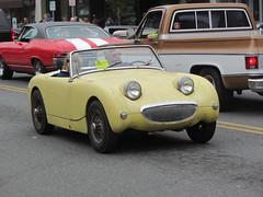 race car(1.0), automobile(1.0), vehicle(1.0), automotive design(1.0), antique car(1.0), austin-healey sprite(1.0), classic car(1.0), vintage car(1.0), land vehicle(1.0), convertible(1.0), sports car(1.0),