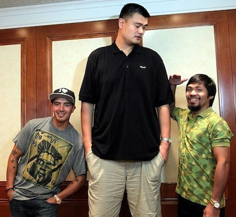 July 30th, 2013 - Yao Ming stands with Manny Pacquiao and Brandon Rios, boxers who were in China to promote their November fight in Macao