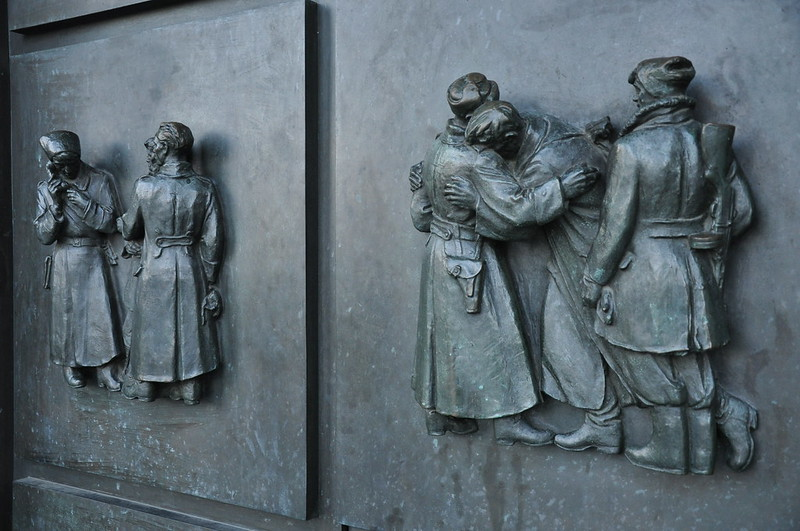 Reliefs on Bronze caisson door commemorating the struggles during the WW II - Slavín monument