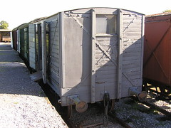 outdoor structure(0.0), shipping container(0.0), public toilet(0.0), portable toilet(0.0), shed(0.0), vehicle(1.0), transport(1.0), freight car(1.0), rolling stock(1.0), cargo(1.0), railroad car(1.0),