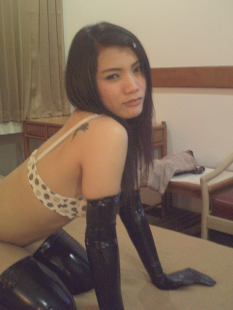 My beautiful asian girlfriend in latex gloves and stockings