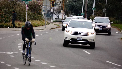 The urban cyclist must brave roving packs of cars
