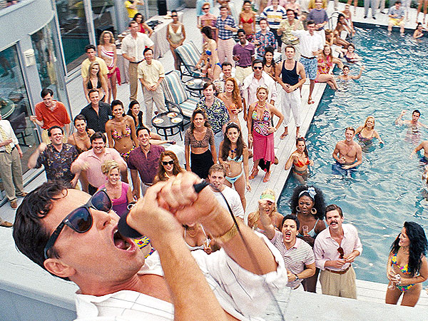 leonardi dicaprio standing over a pool in wolf of wall street