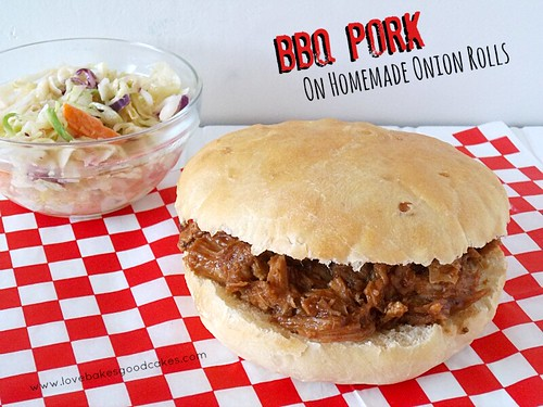 BBQ Pork on Homemade Onion Rolls with coleslaw on red and white checkerboard place mat.