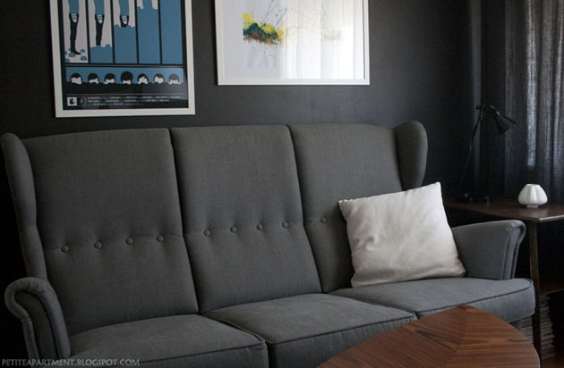 grey strandmon ikea sofa in living room with black grey walls mid century modern inspiration