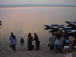 Bathing group on the banks of the Ganges River in Varanasi India. Ablutions in the Ganges.