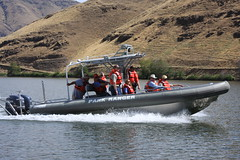 skiff(0.0), watercraft rowing(0.0), bass boat(0.0), vehicle(1.0), boating(1.0), motorboat(1.0), inflatable boat(1.0), rigid-hulled inflatable boat(1.0), watercraft(1.0), boat(1.0),