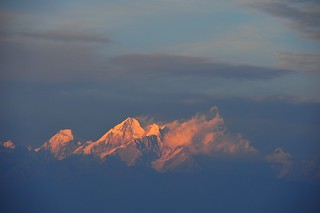 Peaks of the Himalayas in the evening fog