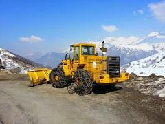 snow removal(0.0), asphalt(1.0), vehicle(1.0), transport(1.0), construction equipment(1.0), bulldozer(1.0),