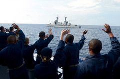 Sailors aboard USS Fitzgerald (DDG 62) wave at the Philippine Navy frigate Gregorio Del Pilar (PF 15) during CARAT Philippines 2013. (U.S. Navy photo by Mass Communication Specialist 1st Class Jay C. Pugh)