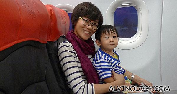 Rachel and Asher on an AirAsia flight