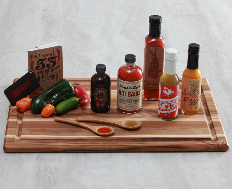 Hot sauce gift set featuring five of the most awesome chili sauces in the US, plus a hot sauce tasting book
