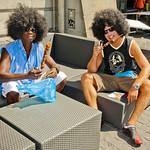 2 boys with long hair eating shashlik  . Zurich  Street Parade 2013.No. 6837.