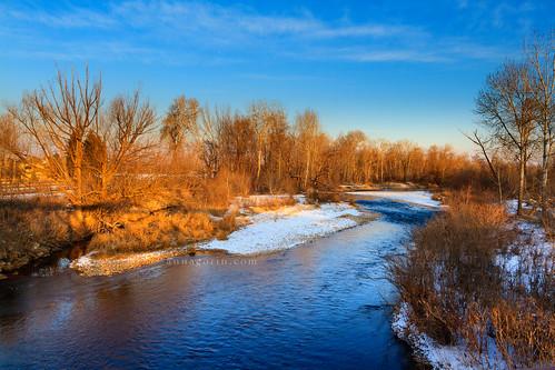 trees winter sunset snow motion ice water canon river landscape flow frozen sigma bluesky idaho boise 7d flowing baretrees goldenhour boiseriver 1750mm