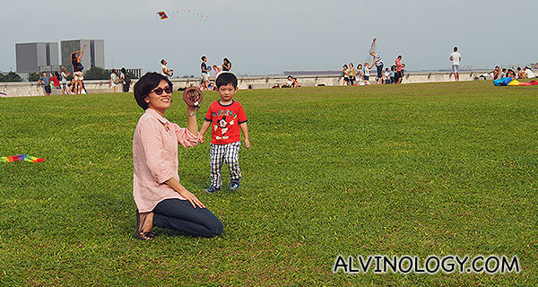 Rachel flying a kite while Asher watches