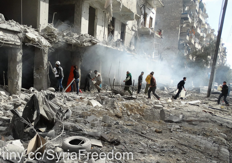 A rescue team arrives at a building following an air strike by Syrian government forces on January 30, 2014 in the northern Syrian city of Aleppo.