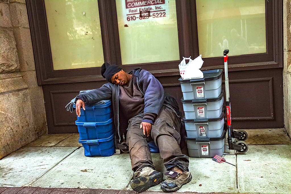 Homeless-man-with-eight-plastic-boxes-on-5-27-14--Center-City