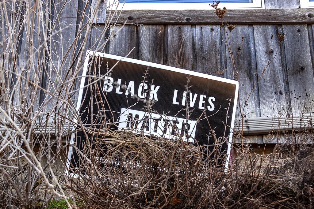 Black Lives Matter sign before house near train station--Ann Arbor