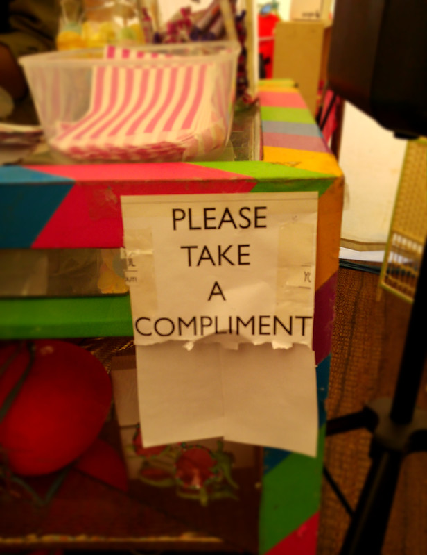 'Please Take a Compliment' sign at Wilderness Festival