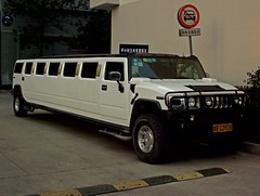 sport utility vehicle(0.0), hummer h1(0.0), hummer h3t(0.0), automobile(1.0), automotive exterior(1.0), vehicle(1.0), hummer h2(1.0), bumper(1.0), land vehicle(1.0), luxury vehicle(1.0), limousine(1.0), vehicle registration plate(1.0), motor vehicle(1.0),