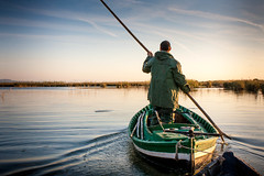 fishing(0.0), sea(0.0), recreational fishing(0.0), fisherman(0.0), paddle(0.0), water(1.0), vehicle(1.0), river(1.0), watercraft rowing(1.0), boating(1.0), reflection(1.0), boat(1.0),