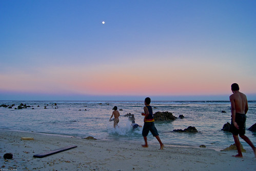 sunset red sky people sun moon beach swim children island evening pacific dusk south wave islander full dip nauru