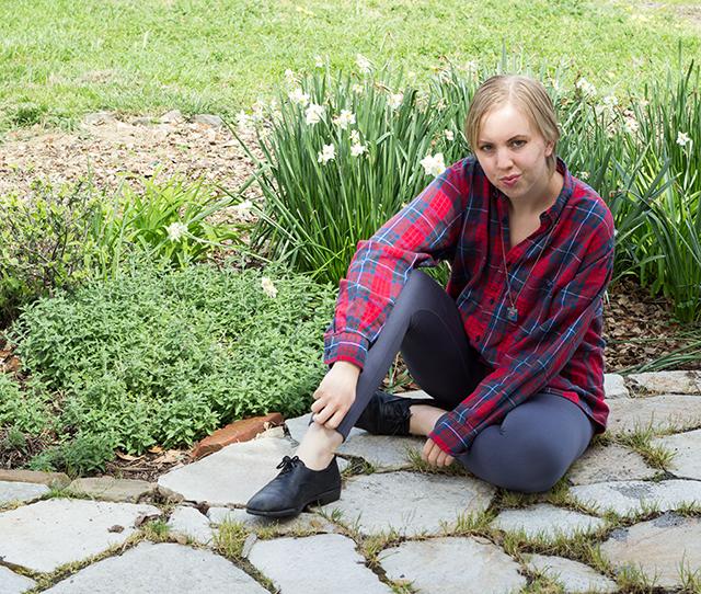 red plaid shirt, grey leggings, blooming garden