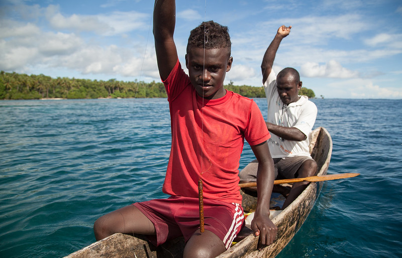 Men prepare to drop their fishing lines, Santupaele village, Western Province, Solomon Islands. Photo by Filip Milovac.
