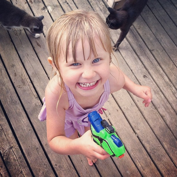 Trying to sneak up on mommy! #watergunfight #notsosneaky #gigglesgiveheraway #cmig365jun