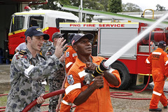 Royal Australian Navy Petty Officer Matthew Marson helps train the local fire fighters at the Wewak Fire Station during the Pupua New Guinea phase of Pacific Partnership 2013. (Royal Australian Navy photo)