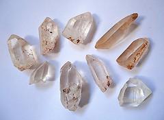 hand(0.0), jewellery(0.0), quartz(1.0), mineral(1.0), stone tool(1.0),