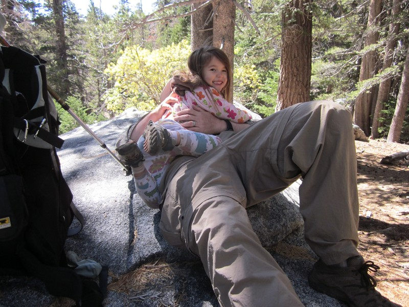 Joyce photobombs a shot of Hikin Jim relaxing on a granite slab in Tamarack Valley