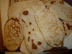 meal(0.0), breakfast(0.0), bread(0.0), baked goods(0.0), ciabatta(0.0), chapati(0.0), flatbread(1.0), food(1.0), piadina(1.0), dish(1.0), naan(1.0), bazlama(1.0), cuisine(1.0),
