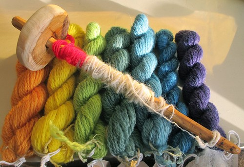 Handspun and hand dyed yarn from The Outside, with hand carved drop spindle