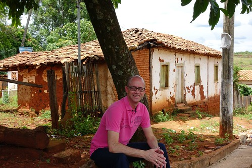 Sitting in front of abandoned house in Romaria, Brazil