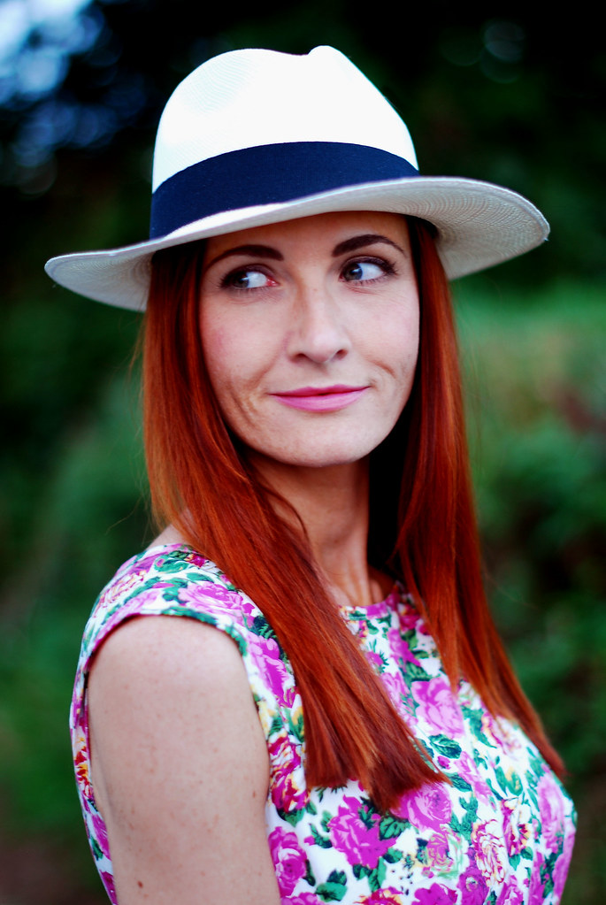 Red hair, Panama hat & pink florals
