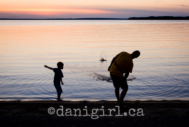 photo of family playing on the beach in Ottawa)
