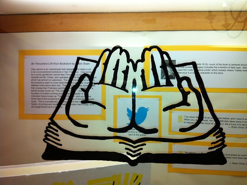 Open hands design  from Mr/ Penumbra's bookstore window