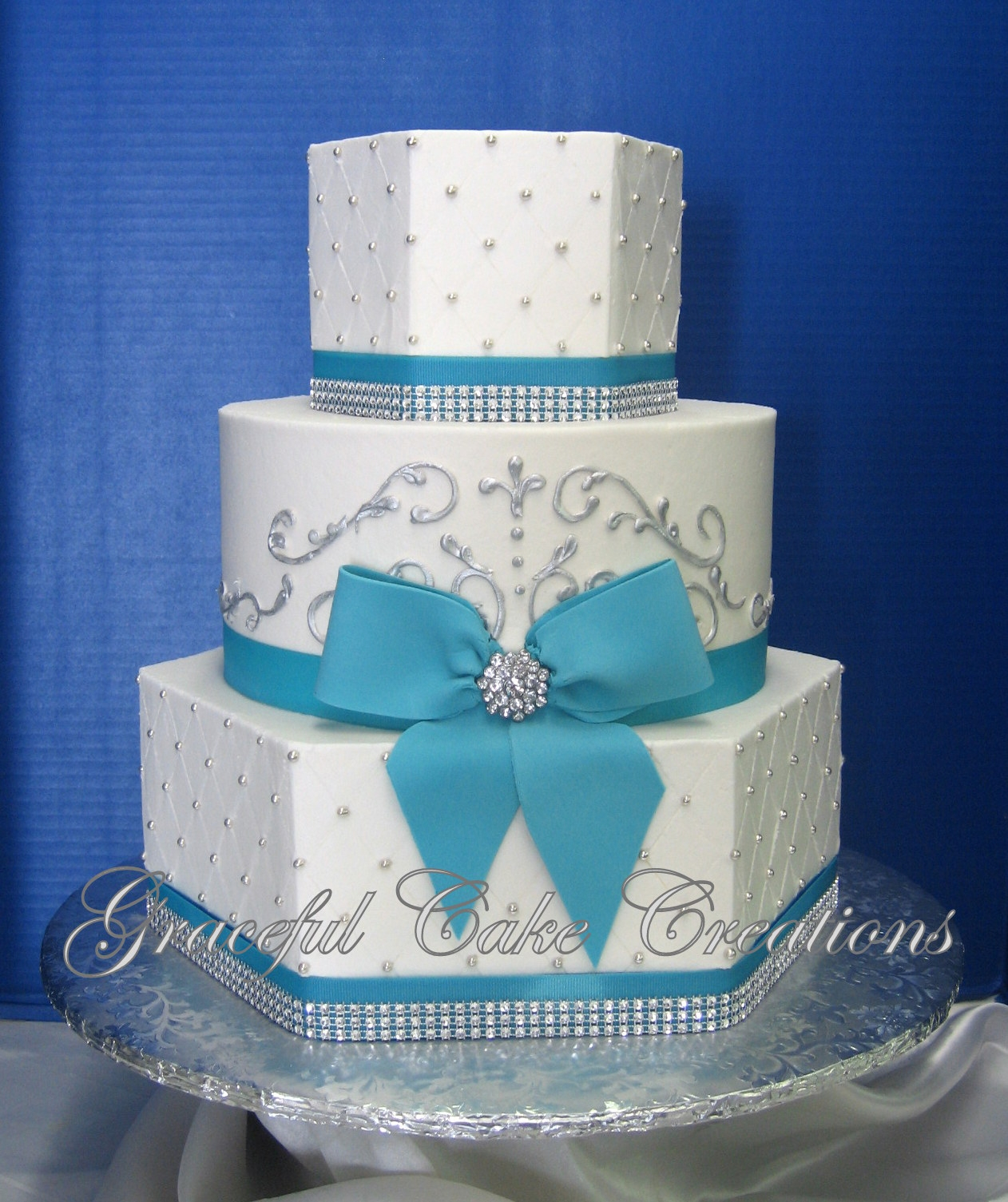 Elegant White Butter Cream Wedding Cake with Tiffany Blue