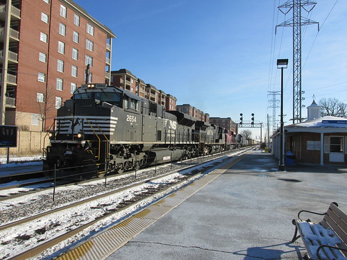 A northbound Norfolk Southern Railroad freight train passes through the Morton Grove Metra commuter rail station.  Morton Grove Illinois.  Thursday, December 12th, 2013. by Eddie from Chicago