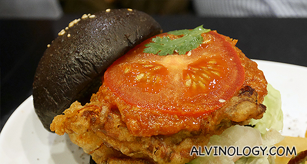 The inside of the burger with chili crab sauce and tomato
