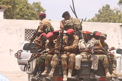 Somali Army soldiers patrolling a street in the capital Mogadishu on Feb. 23, 2014. Concern grows as hundreds of soldiers who were fired from the army in a restructuring drive protested against their termination of service. Credit: Ahmed Osman/IPS