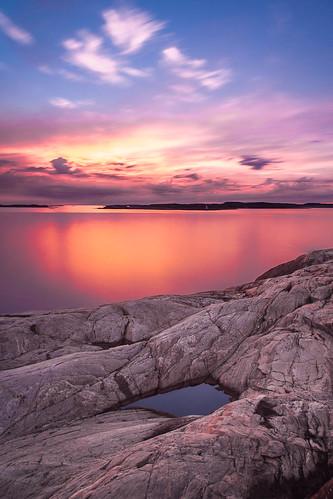 ocean longexposure sunset sea sky cliff sun reflection rock clouds mirror dof sweden pov nd bohuslän grundsund ndfilter nd16