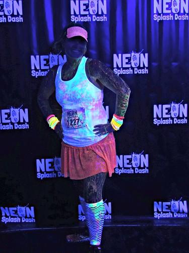 A neon splattered woman.