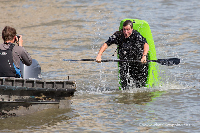 canoeist performs stunts in the River Thames