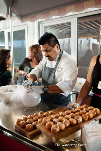 Pastry Chef Carlos Enriquez of Patina Restaurant Group (Los Angeles, CA) - Maple bacon bombolonis and spicy kettle corn chicharrones in liquid nitrogen