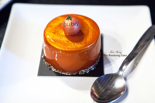 Mandarin orange, milk chocolate mousse, lemon, and hazelnut praline cake