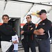 (L to R) Juan Pablo Montoya, Helio Castroneves, and Rick Mears overlook crew preparations before Juan Pablo's initial test laps with Team Penske