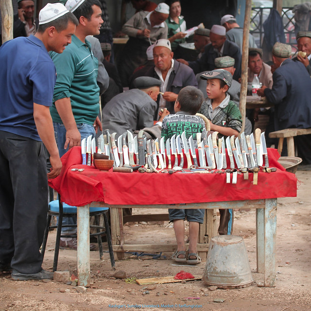 Handmade knives for sale  inside the Sunday Livestock Market in Kashgar